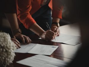 Woman signing document
