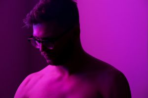 Man purple background